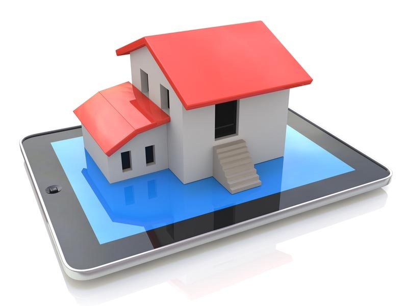 tablet with house model