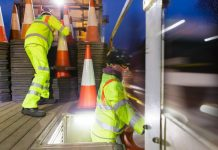 road workers, cone laying,