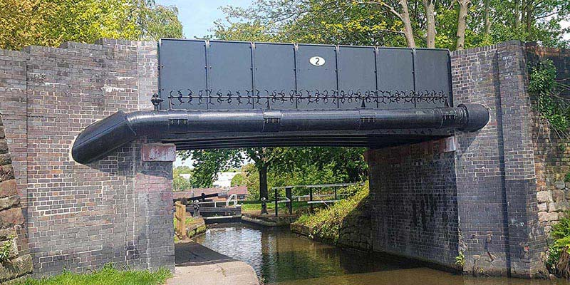 Canal bridge restoration using FRP panels and arched FRP deck supports
